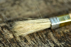 Paint brush on a old wooden background Stock Images