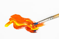 Paint brush with orange painting Royalty Free Stock Images
