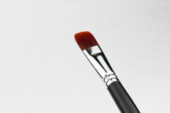 Paint brush over canvas Royalty Free Stock Photos