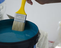 Paint Brush over Paint can Royalty Free Stock Photo
