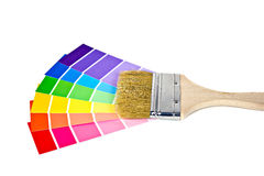 Paint brush on paint chips Stock Photography