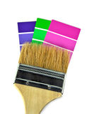 Paint brush on paint chips Stock Photos