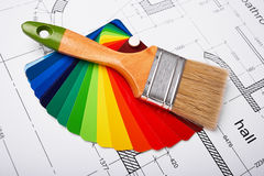 Paint brush and paint palette. Construction of the building layout, building drawing on paper, paint brush and color samples, selecting paint colors Royalty Free Stock Image