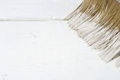 Paint brush on a painted wooden surface, background, copy space stock photography