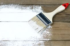 Paint brush on a painted wooden surface, background, copy space royalty free stock photo