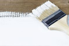Paint brush on a painted wooden surface, background, copy space royalty free stock image