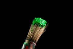 Paint brush painting with green color Royalty Free Stock Photography