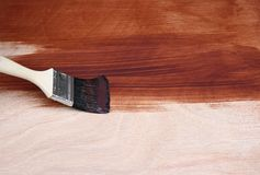 Paint brush painting wood Royalty Free Stock Image