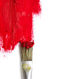 Paint brush paints the white surface with red color, concept rep Royalty Free Stock Photos
