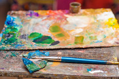 Paint brush, palette of colors. Still life, art workshop. Royalty Free Stock Photography