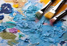 Paint brush. And palette with several colors Royalty Free Stock Photo