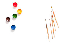 Paint and brush on the paper on a white background Stock Photography