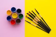 Paint, brush, pink and yellow background. royalty free stock photo