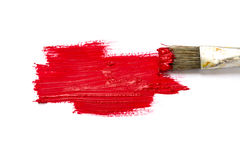 Paint brush with red color and paint stroke  on white ba Royalty Free Stock Photo