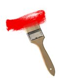 Paint brush with red paint stroke isolated on white Royalty Free Stock Image