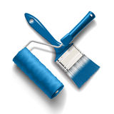 Paint brush and roller. Work tools - paint brush and roller with blue color paint Royalty Free Stock Image