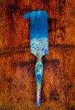 Paint brush on rust Stock Photo