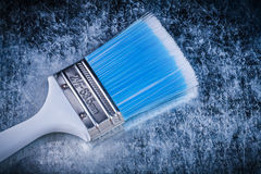 Paint brush on scratched metallic background construction concep Stock Photos