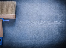 Paint brush with thick bristle on wooden board Stock Photo