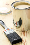Paint brush and tin can. On crackle wooden background Stock Photos