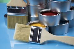 Paint brush, tin can and color guide samples. Tin metal cans with color paint and paintbrush Royalty Free Stock Photo