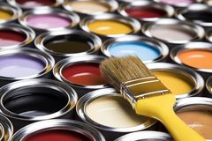 Paint brush, tin can and color guide samples. Tin metal cans with color paint and paintbrush Stock Photography