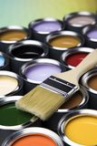 Paint brush, tin can and color guide samples. Tin metal cans with color paint and paintbrush Royalty Free Stock Photos