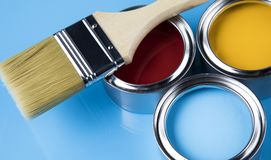 Paint brush, tin can and color guide samples. Tin metal cans with color paint and paintbrush Stock Image