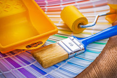 Paint brush tray and roller on color palette Stock Image