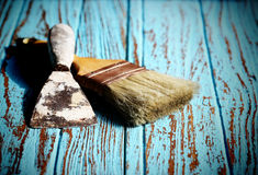 Paint Brush and Trowel scraping on the wood Table Paint by cyan color Stock Photography