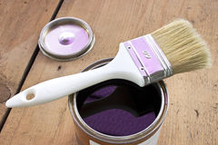 Paint brush and varnish can. On wooden background Stock Photo
