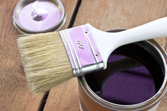 Paint brush and varnish can. On wooden background Royalty Free Stock Photo