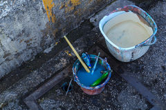 The paint brush was immersed in a bucket of water. Stock Image