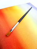 Paint brush on watercolor washed background Royalty Free Stock Photography