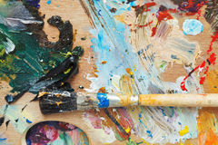 Paint brush on wood artistic pallette Royalty Free Stock Images