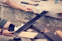 Paint brush on wood Stock Images