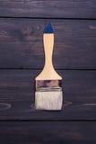 Paint brush on wood Stock Image