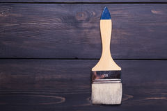 Paint brush on wood Royalty Free Stock Photography