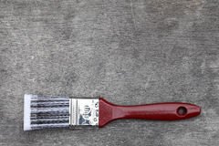 Paint brush on wood plank  Royalty Free Stock Photo