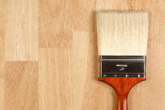Paint Brush on Wood Surface Royalty Free Stock Images