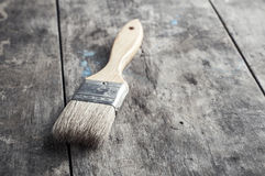 Paint Brush on a Wood Surface Royalty Free Stock Photography
