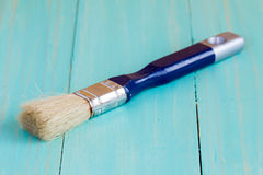 Paint brush on a wood surface Royalty Free Stock Photos
