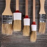 Paint brush on a wooden background Stock Photography