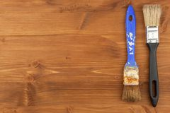 Paint brush on wooden background. Sales of paints and brushes. Housework. Supplies for painters. Stock Photography