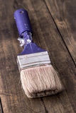 Paint brush on a wooden board Royalty Free Stock Image