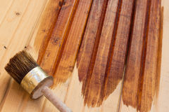 Paint brush on a wooden floor Stock Photography