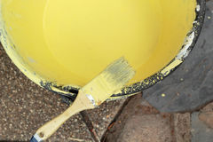 Paint brush with yellow paint Stock Image