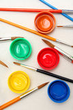 Paint and brushes. Preparing the pallete with brushes and paint Royalty Free Stock Image