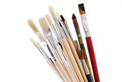 Paint brushes. Used and new paint bruses for painting, used in class for learning Stock Images