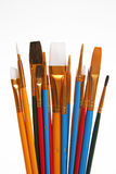 Paint brushes. An assortment of paint brushes in different sizes, shapes and colors Royalty Free Stock Photo
